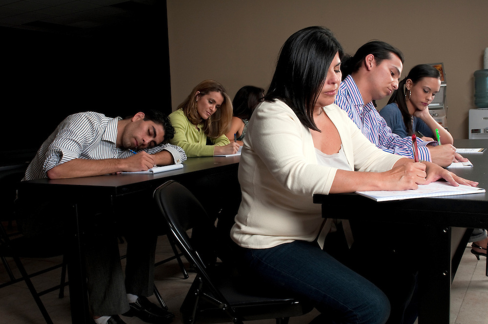 Student falling asleep during a night class training in a corporate classroom.