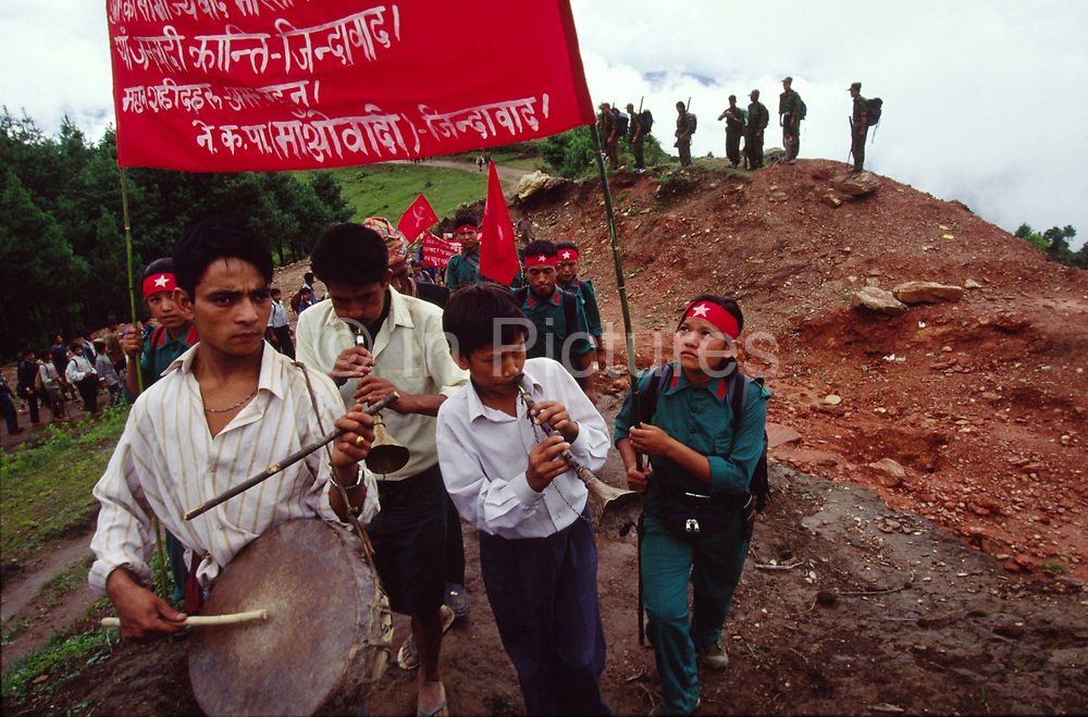 Musicians play the way to a mass rally for Maoists and their supporters, Dolakha, Nepal