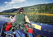 Paddle into adventure at Bowron Lake Provincial Park, British Columbia, Canada. On the 73-mile Bowron canoeing trip, paddle a rectangular circuit of wilderness lakes and portage your canoe rolled on wheels. The Cariboo Mountains are the northernmost subrange of the Columbia Mountains.
