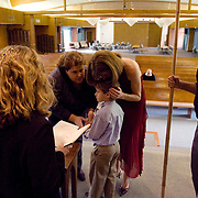 Nicole Bauer and Susan Cohen, sharing a moment with their son, Spencer, wed in Temple Judea hours before the polls close in California where voters were deciding on Proposition 8, a ban on gay marriage.