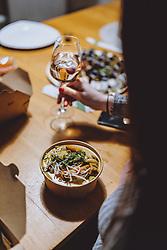 THEMENBILD - eine Frau mit einem Glas Wein und Speisen von einem Restaurant nach Hause geliefert, aufgenommen am 05. Feber 2021 in Kaprun, Österreich // a woman with a glass of wine and food delivered from a restaurant at home, Kaprun, Austria on 2021/02/05. EXPA Pictures © 2021, PhotoCredit: EXPA/ JFK