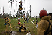 Rookie smokejumpers develop their abilities on the Let-Down Simulator in wet conditions at the McCall smokejumper base in McCall, ID.
