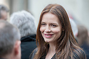 Saffron Burrows chats afterwards. Tony Benn's funeral at 11.00am at St Margaret's Church, Westminster. His body was brought in a hearse from the main gates of New Palace Yard at 10.45am, and was followed by members of his family on foot. The rout was lined by admirers. On arrival at the gates it was carried into the church by members of the family. Thursday 27th March 2014, London, UK. Guy Bell, 07771 786236, guy@gbphotos.com