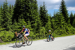 Cycler with a dog competes at Sloveian Road Cycling Championship Time Trial 2020 Gorje - Pokljuka, on June 28, 2020 in Pokljuka, Slovenia. Photo by Matic Klansek Velej / Sportida