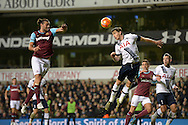 Jan Vertonghen of Tottenham Hotspur (r) heads the ball over Andy Carroll of West Ham United. Barclays Premier league match, Tottenham Hotspur v West Ham Utd at White Hart Lane in London on Sunday 22nd November 2015.<br /> pic by John Patrick Fletcher, Andrew Orchard sports photography.