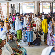 INDIVIDUAL(S) PHOTOGRAPHED: N/A. LOCATION: Felege Hiwot Referral Hospital, Bahir Dar, Ethiopia. CAPTION: The Outpatient Department can get very crowded. Patients and families stand in line to get checked in for treatment, while others wait patiently to be called.