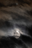 The moon and Jupiter shine through the clouds over Middletown, N.Y.,  on Aug. 28, 2020.