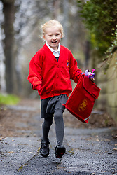 © Licensed to London News Pictures. 08/03/2021. Leeds UK. 5 year old Scarlet, a year one pupil at Temple Newsam Primary school in Leeds, Yorkshire, skips back to the classroom this morning after months of home schooling. Photo credit: Andrew McCaren/LNP