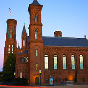 Twilight descends on the landmark Castle building of the Smithsonian Institution in Washington, DC.
