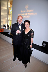 MR & MRS ANTON MOSIMANN at the presentation of the Veuve Clicquot Business Woman Award 2009 hosted by Graham Boyes MD Moet Hennessy UK and presented by Sir Trevor Macdonald at The Saatchi Gallery, Duke of York's Square, Kings Road, London SW1 on 28th April 2009.