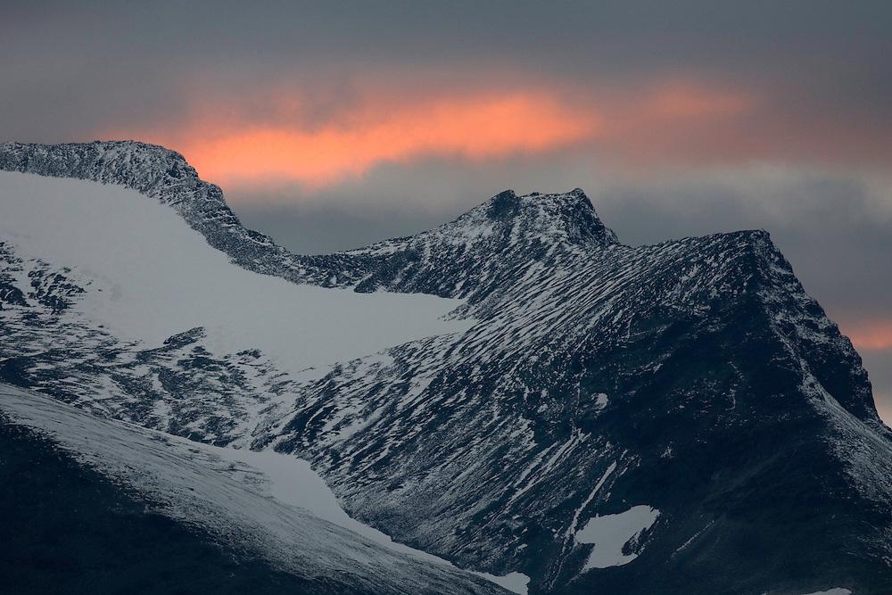 Sunset over snow-capped mountain range, Sarek National Park, Laponia World Heritage Site, Sweden
