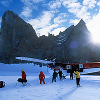 ANTARCTICA, Queen Maud Land.  Expedition unloads Twin Otter at Rakekniven base camp in Filchner Mts.
