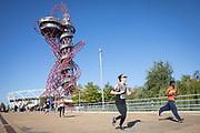 Runners taking part in a 10 kilometre running event, with the ArcelorMittal Orbit on the horizon, at the Queen Elizabeth Olympic Park on the 21st September 2019 in London in the United Kingdom. RunThrough is a London based running community who organise regular running events, training sessions as well as coaching.