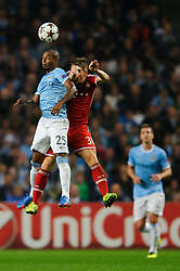 Man City Midfielder Fernandinho (BRA) and Bayern Midfielder Bastian Schweinsteiger (GER) compete in the air during the first half of the match - Photo mandatory by-line: Rogan Thomson/JMP - Tel: Mobile: 07966 386802 - 02/10/2013 - SPORT - FOOTBALL - Etihad Stadium, Manchester - Manchester City v Bayern Munich - UEFA Champions League Group D.