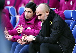 Manchester City manager Pep Guardiola (right)