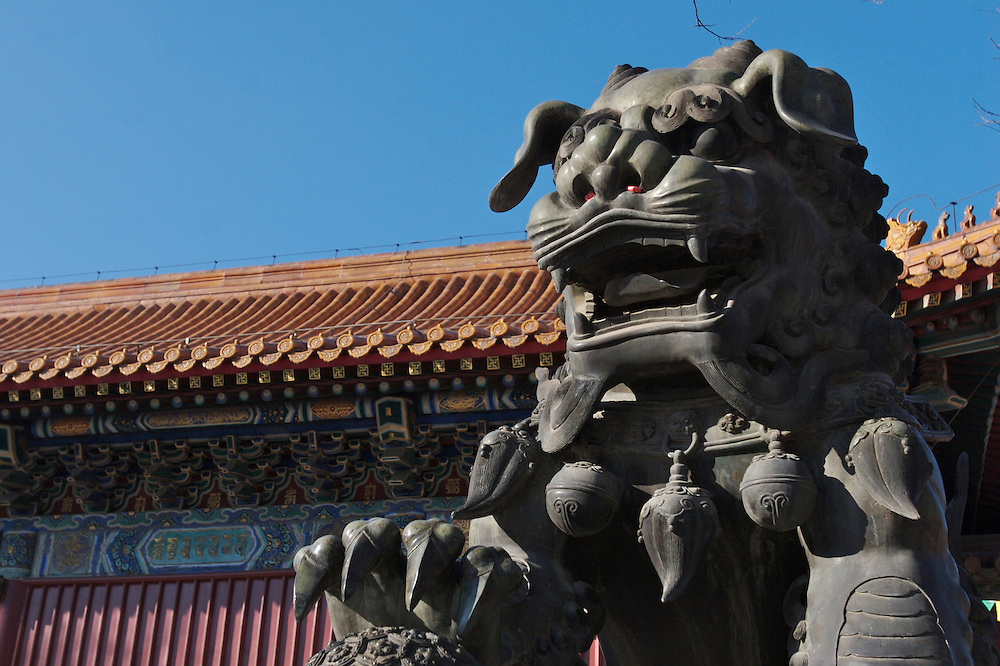 A statue at Yonghegong.  This Tibetan Temple is known to tourists as Lama Temple and it's located in Dongcheng District Beijing, China. This is the largest Temple of its kind outside of Tibet.  In 1723 the structure was turned into a Temple after the resident became the third Qing Emperor.