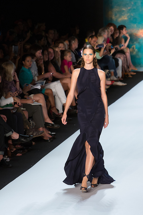 Black halter-top gown. By Monique Lhuillier at Spring 2013 Fall Fashion Week in New York.