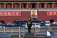 Guard in Tiananmen Square with the Forbidden City in the background.