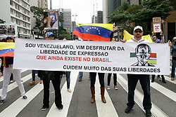 April 29, 2017 - Sao Paulo, Sao Paulo, Brazil - Venezuelans living in Brazil, protest against Venezuelan President Nicolás Maduro on Avenida Paulista in São Paulo, Brazil, on Saturday 29 April 2017. Venezuelans request a statement from the international community about human rights violations and the behavior of Nicolás Maduro's dictatorial regime. (Credit Image: © Fotorua/NurPhoto via ZUMA Press)