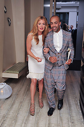 CAT DEELEY and PAUL MURASHE at the second night of the Tomodachi (Friends) Charity Dinners hosted by Chef Nobu Matsuhisa in aid of the Japanese committee for UNICEF held at Nobu Berkeley, Berkeley Street, London on 5th May 2011.