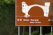 Road sign showing the old bridge in Mostar. Historic town of Mostar. Federation Bosne i Hercegovine. Bosnia Herzegovina, Europe.