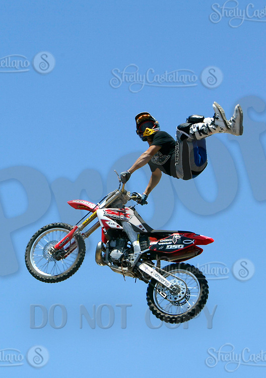 """Jul 01, 2003; Anaheim, California, USA; Moto X star athlete JAMIE MCGUIRE executing a tremendous stunt feet free with a full sized motobike at the opening of Disney's California Adventure """"X Games Experience"""".  Disney park has built two X-Arena's specifically for this 41 day event highlighting extreme sports for the launch of the 2003 ESPN X Games.<br />Mandatory Credit: Photo by Shelly Castellano/Icon SMI<br />(©) Copyright 2003 by Shelly Castellano"""