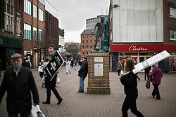 © Licensed to London News Pictures . 03/02/2017. Stoke-on-Trent, UK . People in Hanley town centre by a statue of Sir Stanley Matthews , in the constituency of Stoke-on-Trent Central . The by-election in the constituency is due to take place on 23rd February . Photo credit: Joel Goodman/LNP