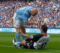 Photo. Glyn Thomas.Digitalsport<br /> Manchester City v Fulham. <br /> Barclays Premiership. 14/08/2004.<br /> Man City's Danny Mills (L) exchanges angry words with Fulham's Thomasz Radzinski.