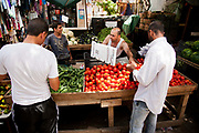 Fruit and vegetable market outside Shatila refugee camp in Beirut. A stall with fresh tomatoes and cucumbers for sale.