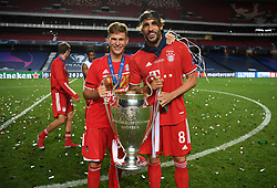 LISBON, PORTUGAL - Sunday, August 23, 2020: FC Bayern Munich's Joshua Kimmich and Javi Martinez (R) celebrate with the European Cup trophy as Bayern win it for the sixth time after the UEFA Champions League Final between FC Bayern Munich and Paris Saint-Germain at the Estadio do Sport Lisboa e Benfica. FC Bayern Munich won 1-0. (Credit: ©UEFA)