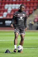 Manny Adebowale (17) of Crawley Town warms up before the EFL Sky Bet League 2 match between Cheltenham Town and Crawley Town at Jonny Rocks Stadium, Cheltenham, England on 10 October 2020.