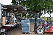 Wine bottling truck with mobile bottling line at Chateau Fontcaille Bellevue vineyard in Bordeaux region of France