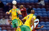 Photo: Paul Greenwood.<br />Burnley v Norwich City. Coca Cola Championship. 17/04/2007.<br />Norwich's Kris Renton (L) beats Wayne Thomas in the air