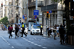BARCELONA (SPAIN), Aug. 17, 2017  Police officers ask people to leave Plaza Catalonia following a terrorist attack in central Barcelona, Spain, on Aug. 17, 2017. Thirteen people were killed, 80 others injured and hospitalized with 15 of them in serious condition in Barcelona terrorist attack on Thursday afternoon, Spanish official said. (Credit Image: © Lino De Vallier/Xinhua via ZUMA Wire)