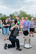 Middletown, New York -  SUNY Orange adjunct assistant professor Tom Blon sets up a telescope to view Venus during an astronomy program on viewing constellations and planets on the Green Patio of the Rowley Center for Science and Engineering on the Middletown campus on May 12, 2015. The hands-on  program was run by Blon and sponsored by SUNY Orange Cultural Affairs.
