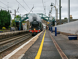 Pictured: Flying Scotsman returns South. Drem station, East Lothian, 27 May 2019. The Flying Scotsman steam locomotive returns South after tours of Scotland, passing through the station early at 6.30am.<br /> Sally Anderson | EdinburghElitemedia.co.uk