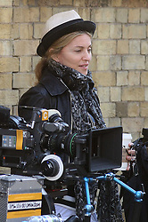 ©London News Pictures. 15/01/2011 .Picture Credit Should read Neil Hall/London News Pictures.Madonna directs her new period film W.E. starring Abbie Cornish about the abdication of King Edward in London on 08/08/2010. Image of Madonna with movie camera