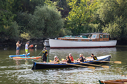 Licensed to London News Pictures. 05/09/2021. London, UK. Paddle boarders and rowers enjoy the warm sun along the Thames at Richmond, south-west London as weather forecaster predict a mini-heatwave for September from today with temperatures hitting over 27c tomorrow and throughout the week. Photo credit: Alex Lentati/LNP