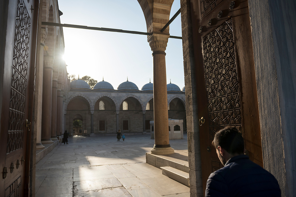 A man enters the courtyard of the Süleymaniye Mosque in Istanbul, Turkey. The mosque was built between 1550 and 1557.