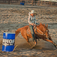 A woman and her horse compete barrel racing at the 2011 Bozeman Stampede in Bozeman, Montana.