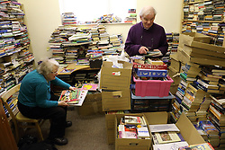 Volunteers sorting books for sale by Mysight charity for people with visual impairments in Nottingham.