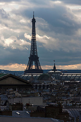 Eiffel Tower against cloudy sky, Paris, France