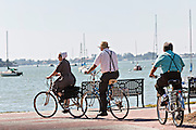Amish people ride bicycles along the waterfront Sarasota, Florida