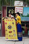 Qiongdao (Jade Island) in Beihai Lake. Fangshan Imperial Food Restaurant. Waitresses with the menue.
