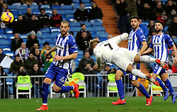 MADRID, Feb. 4, 2019  Real Madrid's Mariano Diaz Mejia (2nd L) scores a header during a Spanish La Liga match between Real Madrid and Alaves in Madrid, Spain, on Feb. 3, 2019. Real Madrid won 3-0. (Credit Image: © Edward F. Peters/Xinhua via ZUMA Wire)