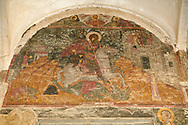 Pictures & images of the medieval fresco of St George over the doorway of the Alaverdi St George Cathedral & monastery complex, 11th century, near Telavi, Georgia (country). <br /> <br /> At 50 meters high Alaverdi St George Cathedral was once the highest cathedral in Georgia (now its the nes Tblisi cathedral). The cathedral is part of a Georgian Orthodox monastery founded by the monk Joseph [Abba] Alaverdeli, who came from Antioch and settled in Alaverdi. On the UNESCO World Heritage Site Tentative List. .<br /> <br /> Visit our MEDIEVAL PHOTO COLLECTIONS for more   photos  to download or buy as prints https://funkystock.photoshelter.com/gallery-collection/Medieval-Middle-Ages-Historic-Places-Arcaeological-Sites-Pictures-Images-of/C0000B5ZA54_WD0s .<br /> <br /> Visit our REPUBLIC of GEORGIA HISTORIC PLACES PHOTO COLLECTIONS for more photos to browse, download or buy as wall art prints https://funkystock.photoshelter.com/gallery-collection/Pictures-Images-of-Georgia-Country-Historic-Landmark-Places-Museum-Antiquities/C0000c1oD9eVkh9c