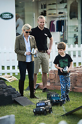 ©London News Pictures. 15/05/2014. Sophie, Countess of Wessex playing with her son James on remote control Land Rovers on day two of the Royal Windsor Horse Show. Sophie, Countess of Wessex and her son also enjoyed a test ride in a full size Land Rover together.. Photo credit: Ben Cawthra/LNP