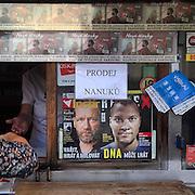 Tabacco shop with ice cream sale. #lysanadlabem #shop #tabaccoshop #street #hand #woman #magazines #czechrepublic #latergram #portraits