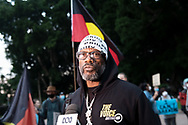 Rodney Overby former Sydney King Basketball player being interviewed at Hyde Park during a 'Black Lives Matter' rally on 02 June, 2020 in Sydney, Australia. This event was organised to rally against aboriginal deaths in custody in Australia as well as in unity with protests across the United States following the killing of an unarmed black man George Floyd at the hands of a police officer in Minneapolis, Minnesota. (Photo by Steven Markham/ Speed Media)