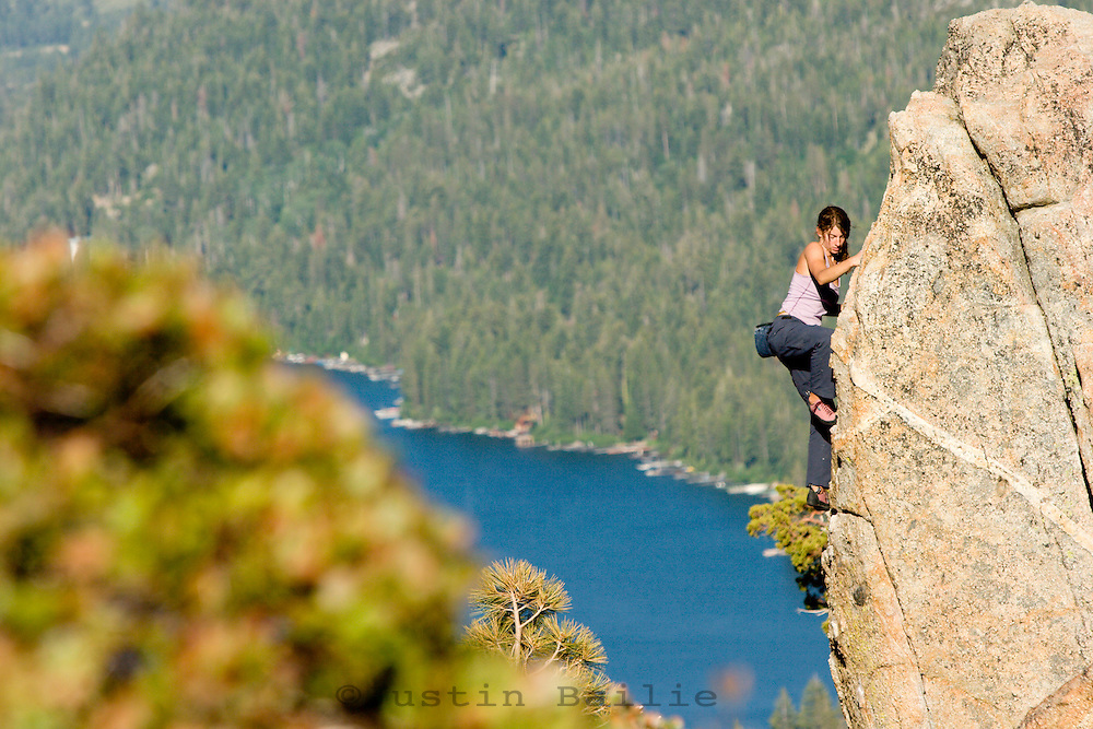 Young woman bouldering on Donner Summit, CA